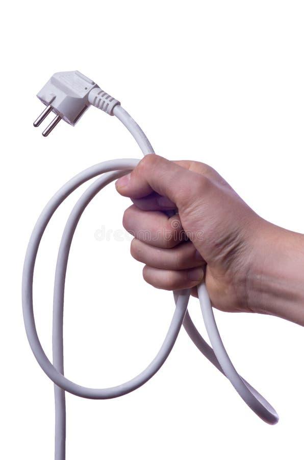 Câble d'alimentation d'énergie de participation de main dans les boucles photos stock