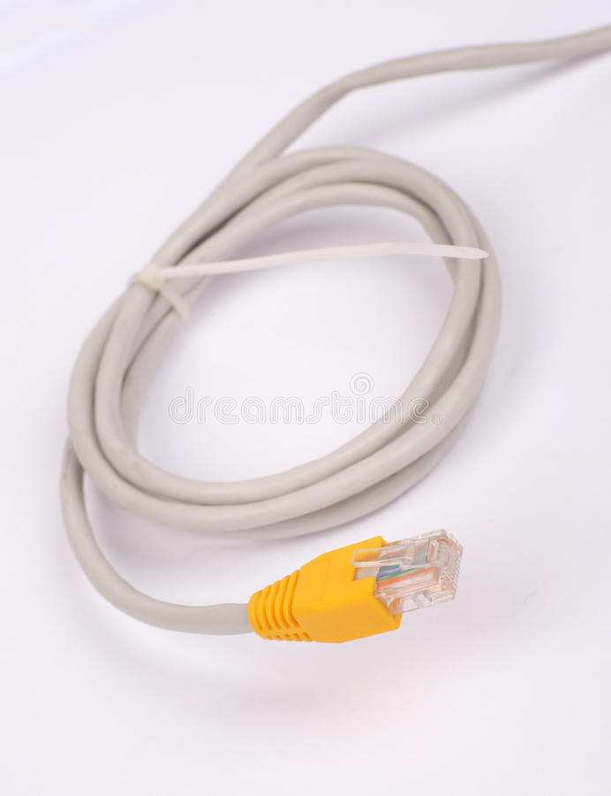 Câble jaune tordu d'ordinateur photos libres de droits