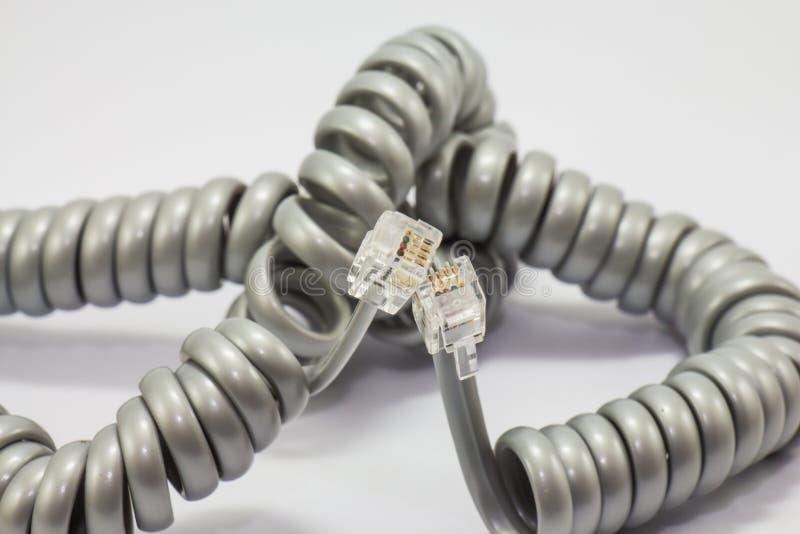 Câble téléphonique en spirale d'isolement photo stock