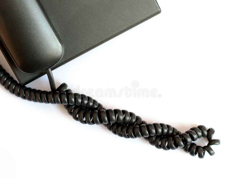 Câble téléphonique spiralé noir photo stock