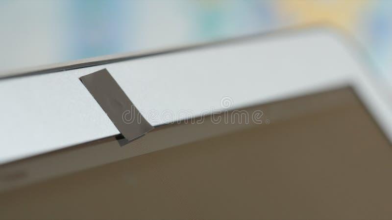 Câmara web do portátil obstruída por uma fita adesiva fotos de stock royalty free