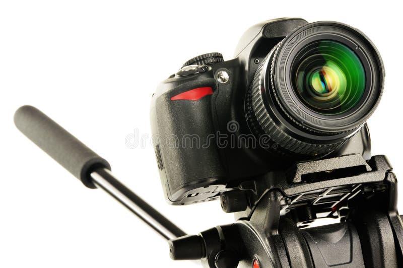câmera de reflexo da Único-lente no tripé isolado no branco fotografia de stock royalty free