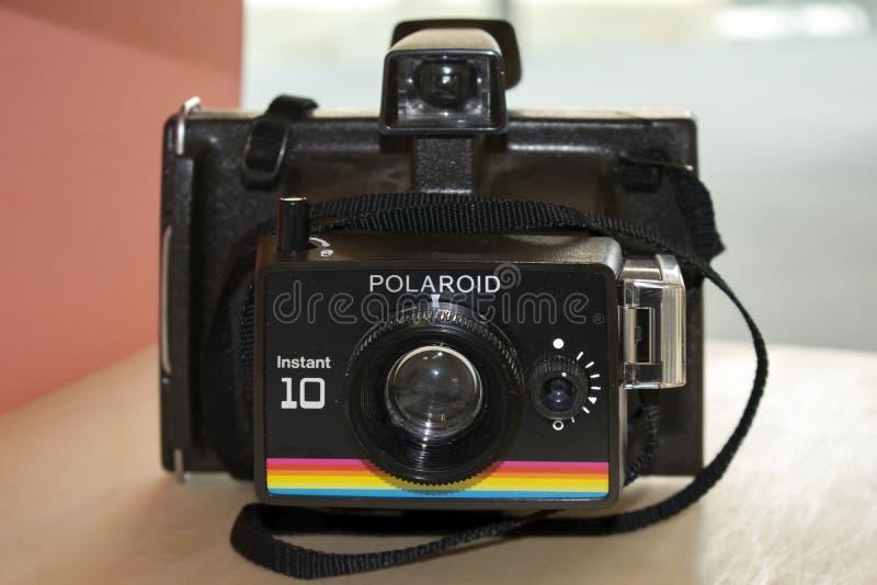 Câmera do instante 10 do Polaroid na exposição em Trent University em Nottingham fotos de stock royalty free