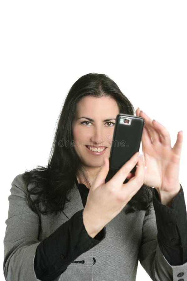 Câmera do telefone de pilha nas mãos da mulher foto de stock royalty free