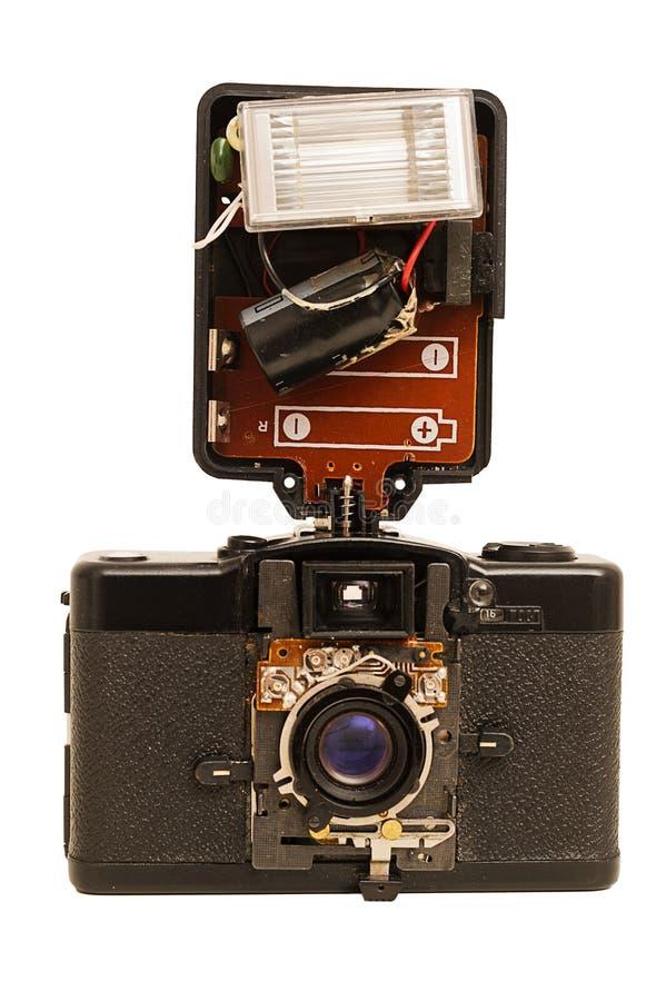 Câmera e flash quebrados velhos da película do russo