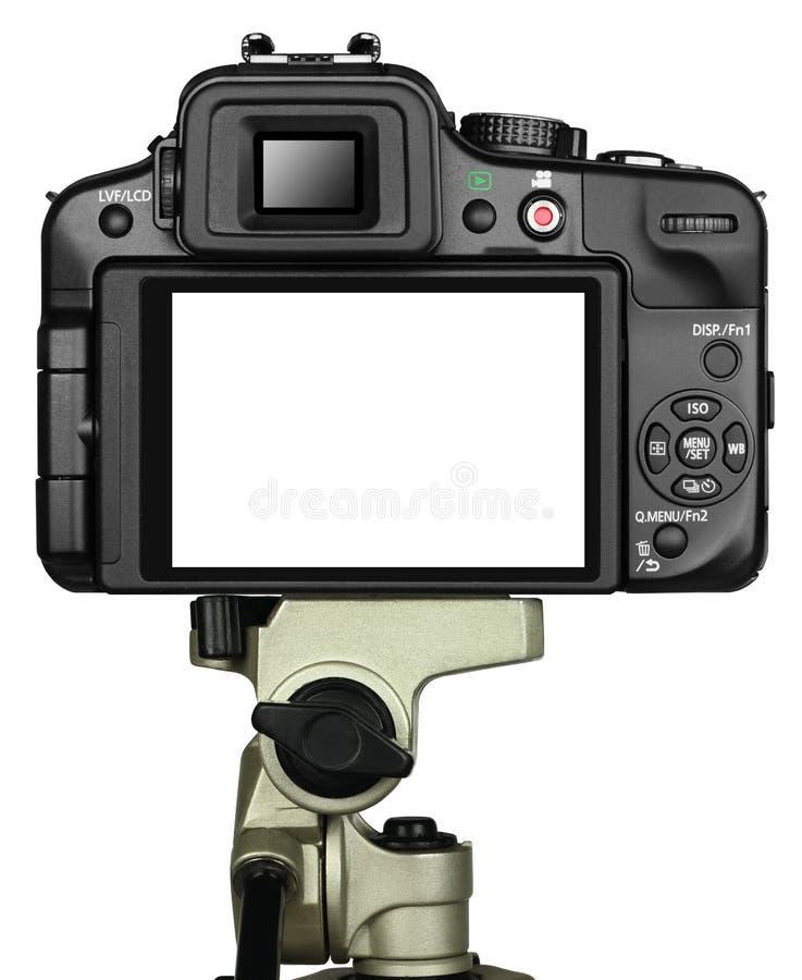 Câmera e tripé imagem de stock