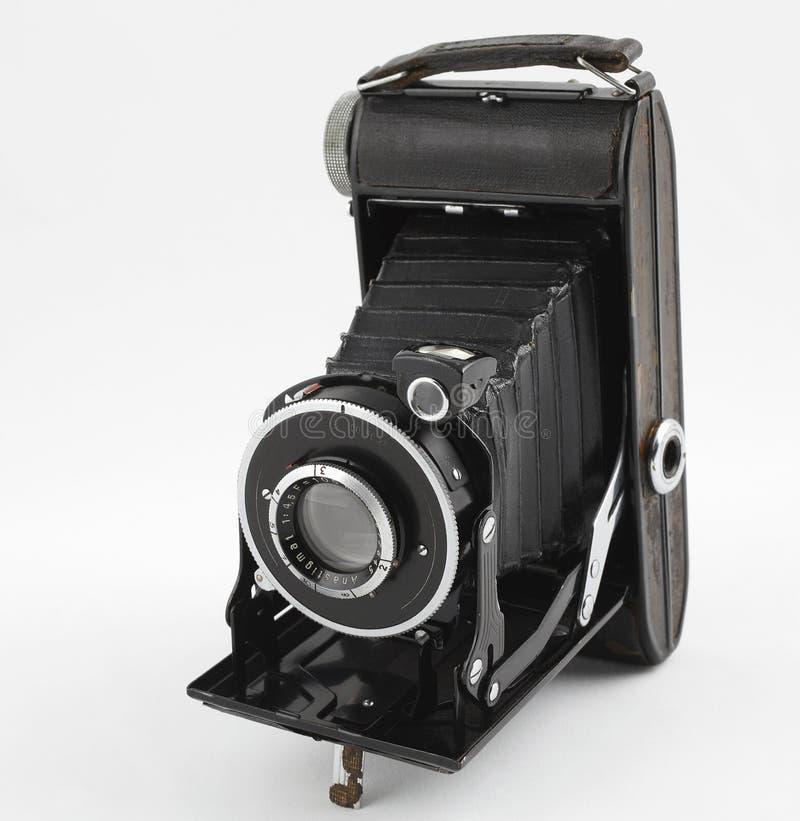 Câmera média velha da foto do formato no fundo branco Front View imagens de stock