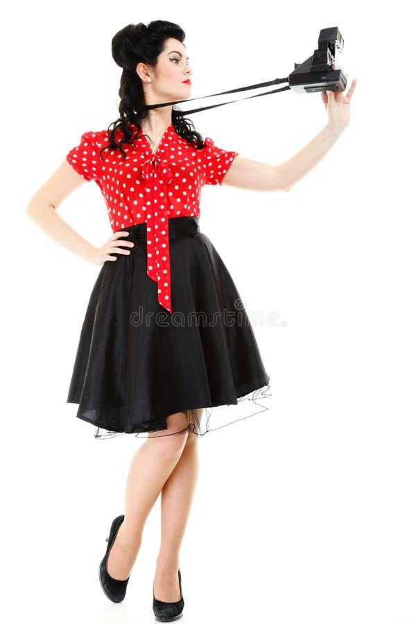Câmera retro da mulher do estilo americano da menina Pin-acima fotografia de stock