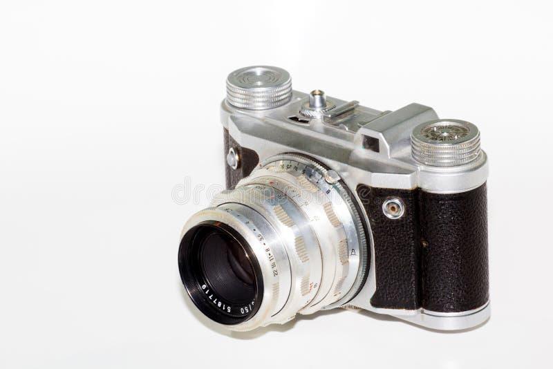 Câmera retro isolada no fundo branco fotografia de stock royalty free