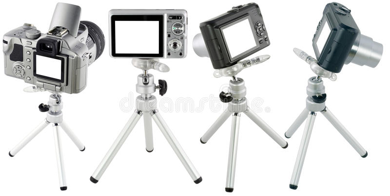 Câmeras compactas no jogo do tripé fotos de stock royalty free