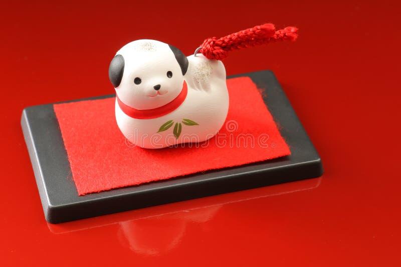 Cão japonês do ano novo no vermelho fotografia de stock royalty free