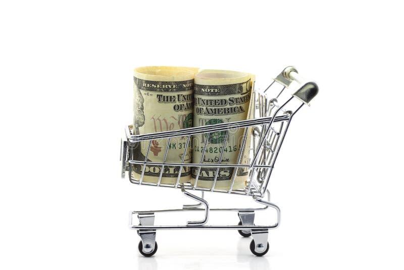 Cédula do dólar no carrinho de compras isolado no fundo branco foto de stock royalty free