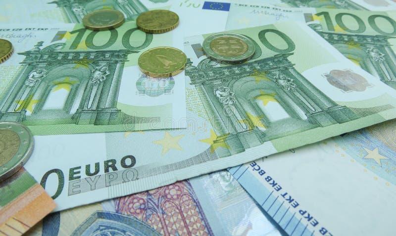 Cédulas do Euro e moedas EUR fotografia de stock