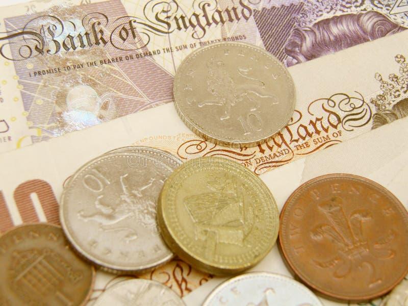 Cédulas e moedas de GBP foto de stock