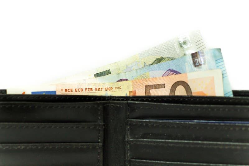 Cédulas e moedas do Euro Dinheiro na carteira Economia em Europa fotos de stock royalty free