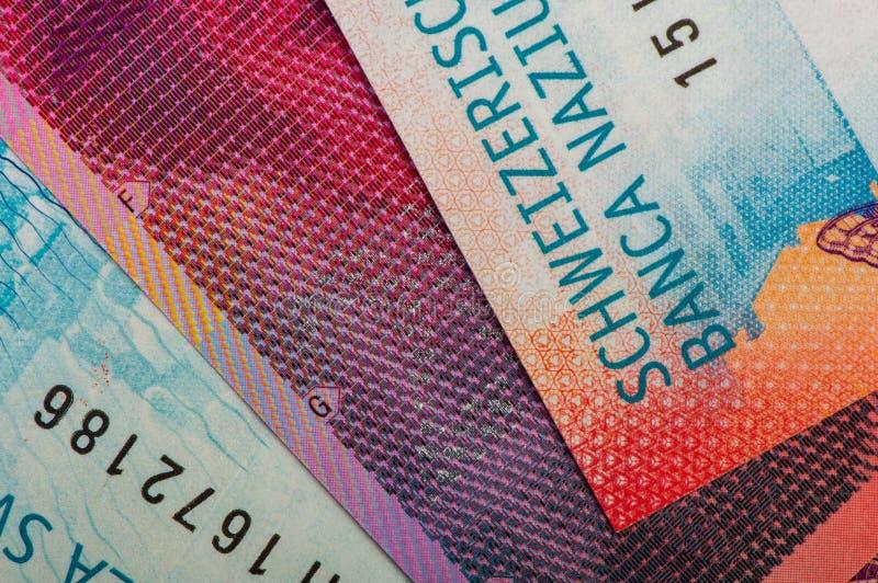 Cédulas suíças do dinheiro Detalhe de um close-up fotografia de stock royalty free