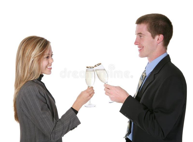 Célébration de couples d'affaires photo stock