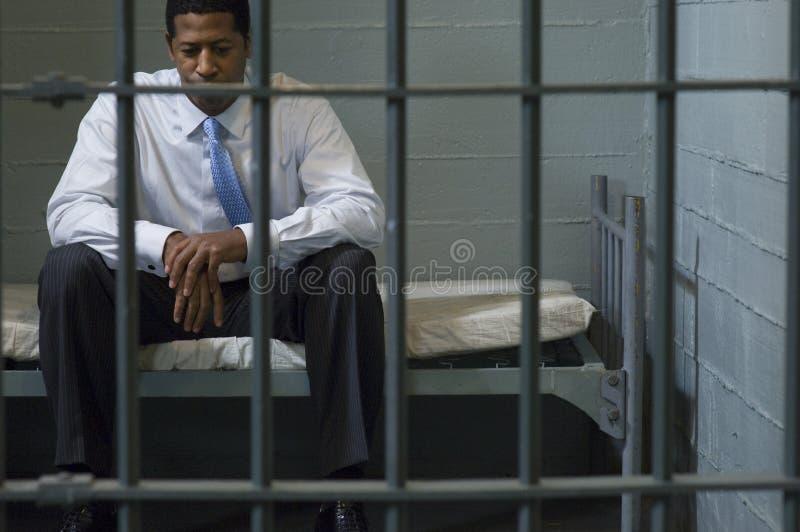 Célula de Sitting In Prison del hombre de negocios foto de archivo libre de regalías