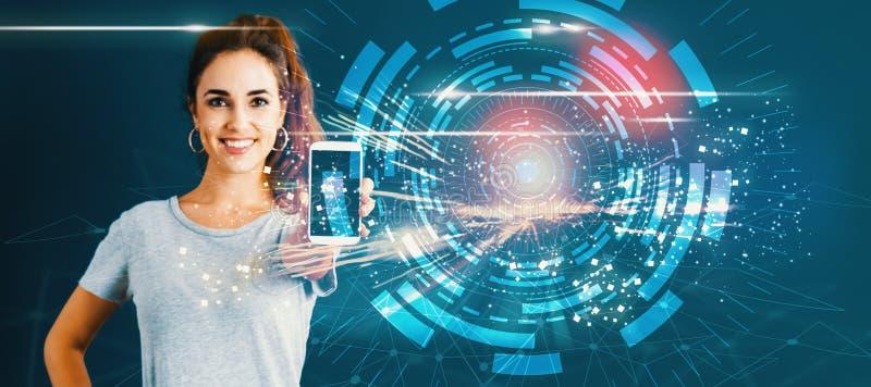 Círculo de la tecnología de Digitaces con la mujer joven que sostiene hacia fuera un smartphone imagen de archivo