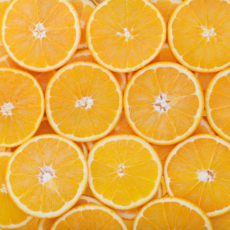 Círculos do corte do fruto tropical como o fundo foto de stock royalty free