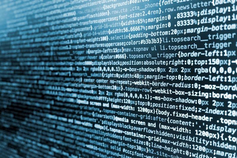 Código de programação do CSS na tela em tons azuis imagem de stock