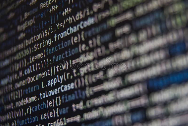 Código de programa en la pantalla fotos de archivo
