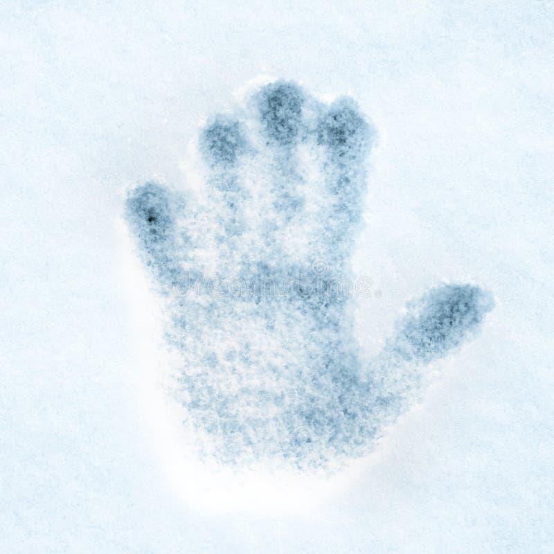 Cópia da mão na neve fotografia de stock royalty free