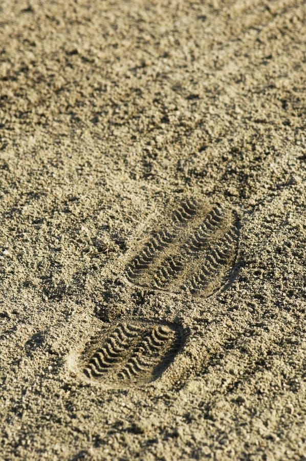 Cópia da sapata na areia imagem de stock