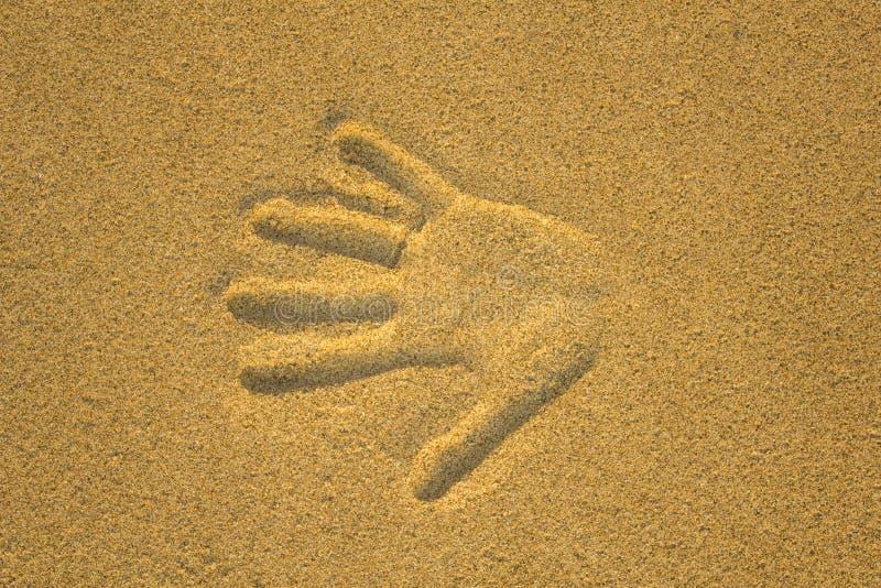 Cópia do assistente no fim amarelo da areia acima imagem de stock royalty free