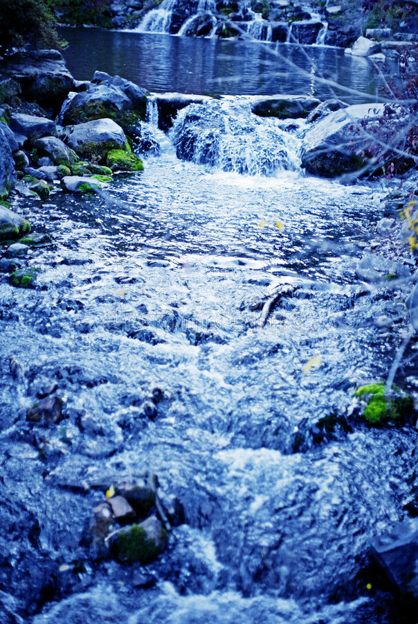 Córrego azul fotografia de stock