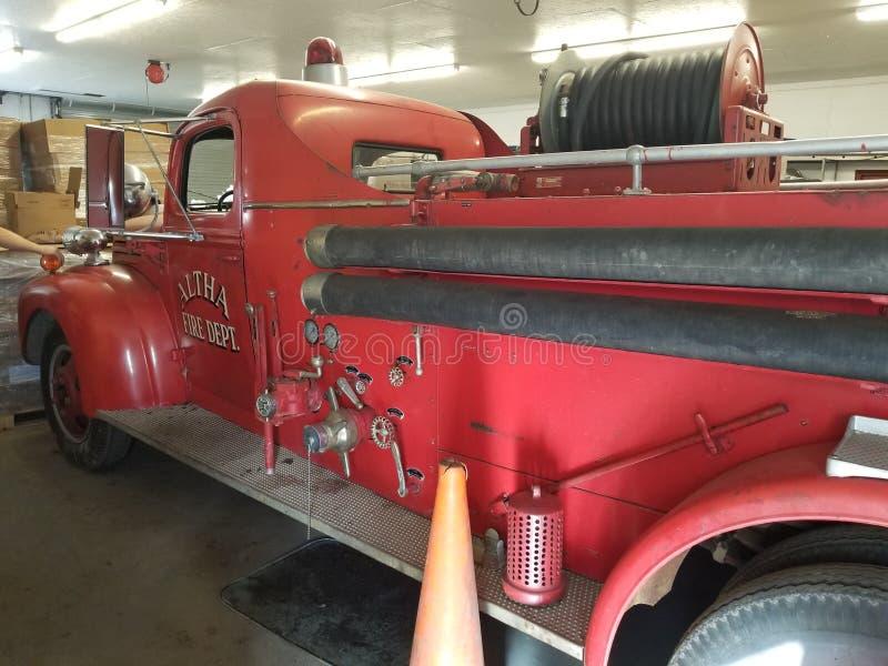 Côté d'un camion de pompiers antique image stock