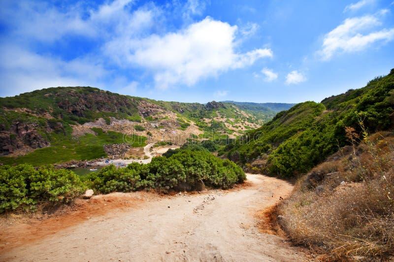 Côte de la Sardaigne, de la mer, du sable et des roches image stock