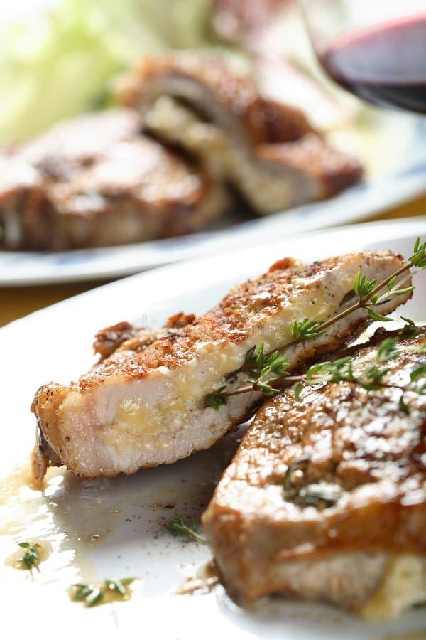 Côtelette avec du fromage photos libres de droits