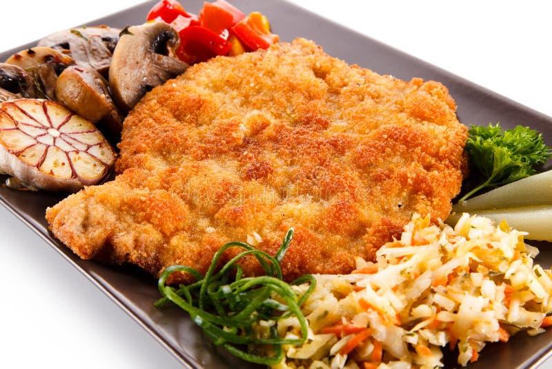Côtelette de porc frite avec des légumes photo libre de droits
