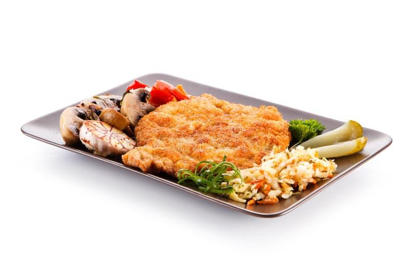 Côtelette de porc frite avec des légumes photos stock
