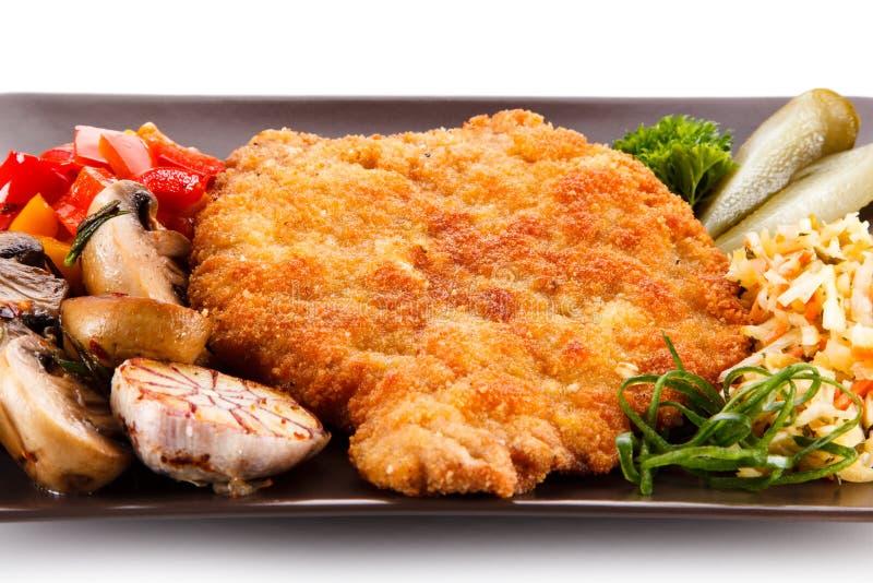 Côtelette de porc frite avec des légumes photos libres de droits