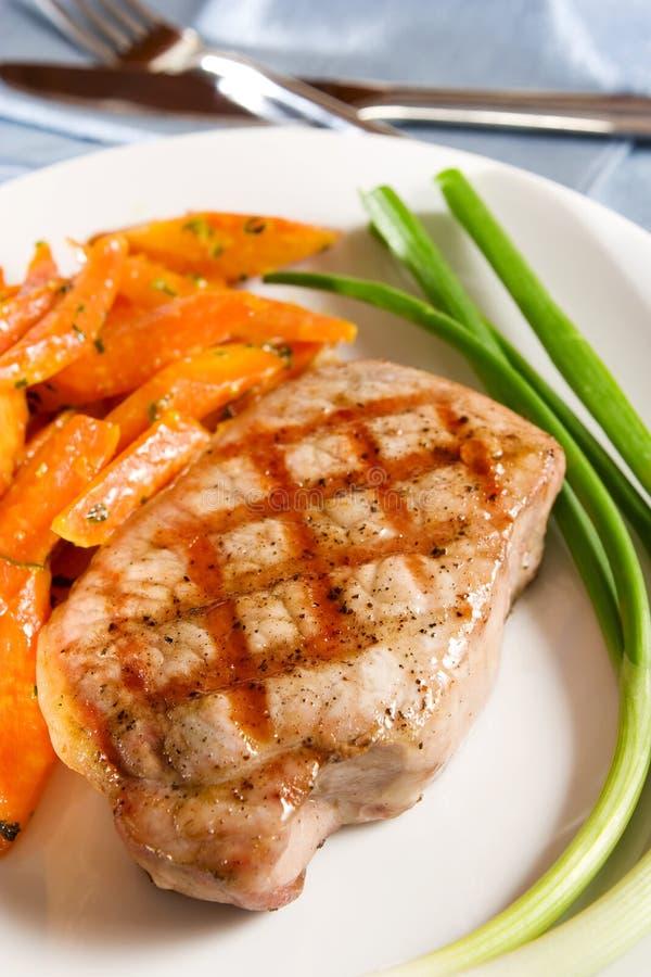 Côtelette de porc grillée image stock