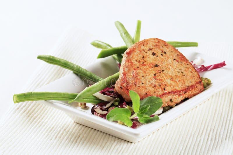 Côtelette et légumes de porc marinée photographie stock