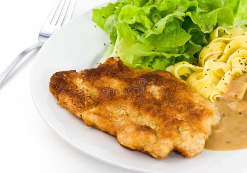 Côtelette panée - Schnitzel - de veau avec de la sauce image libre de droits