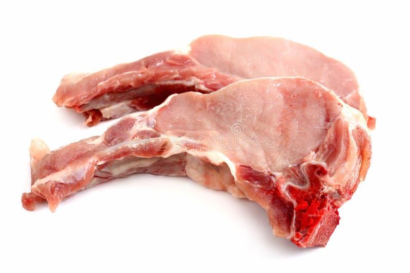 Côtelettes crues d'échine de porc image libre de droits