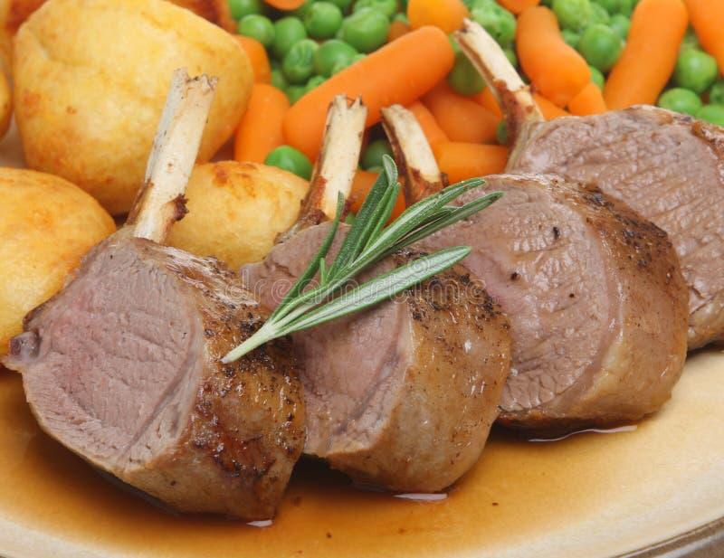 Côtelettes d'agneau de rôti photo stock