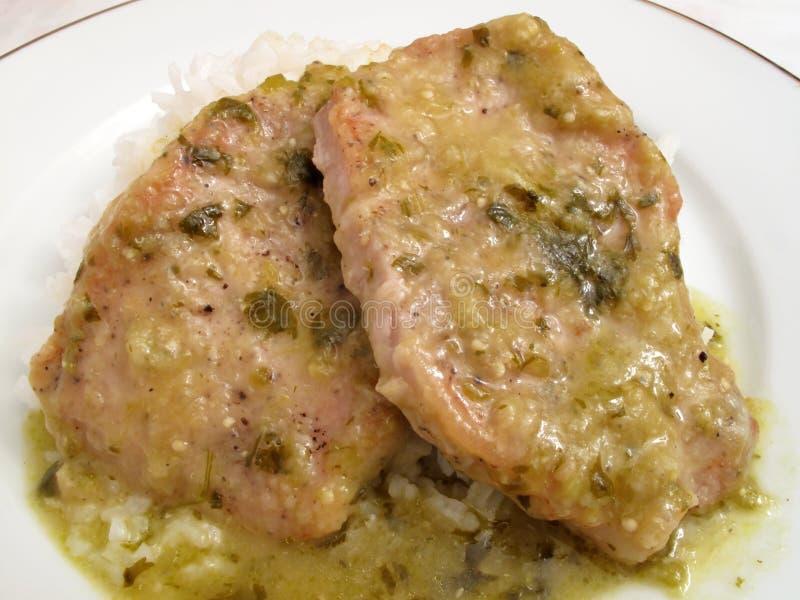 Côtelettes de porc en sauce à Tomatillo photo stock