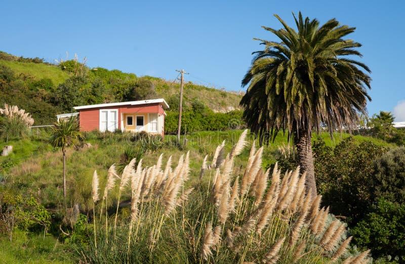 Côtier, rural, maison de vacances, péninsule de Mahia, Côte Est, île du nord, Nouvelle-Zélande images libres de droits