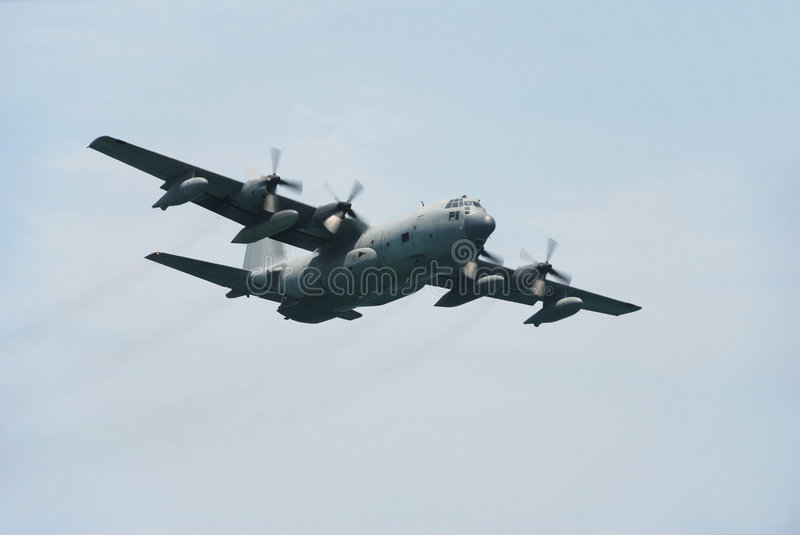 C-130 military transport plane. Approaching c-130 hercules from the us airforce royalty free stock photo
