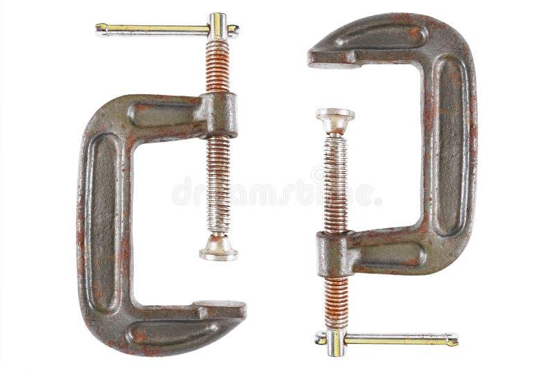 c-braçadeira usada ou g-braçadeira para manter a madeira ou o metal isolada no wh fotografia de stock