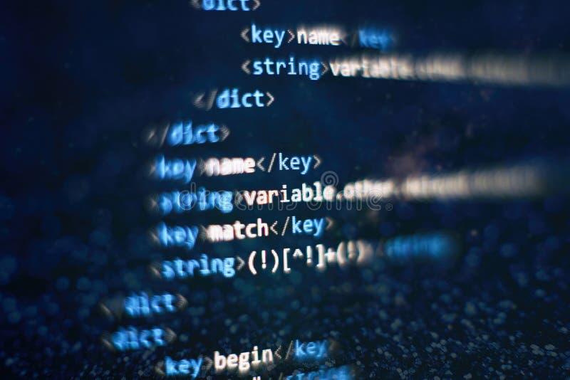 C?digo abstracto de la escritura del ordenador Pantalla programada del c?digo del desarrollador de software Tiempo de trabajo de  fotografía de archivo libre de regalías