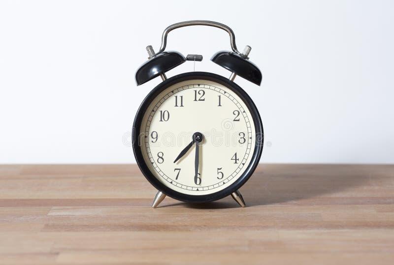 C'est horloge de ` du 7h30 o photo stock