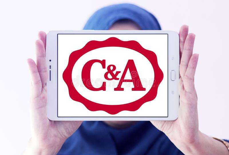 C&A retailer logo. Logo of C&A retailer on samsung tablet holded by arab muslim woman. C&A is an international chain of fashion retail clothing stores, with royalty free stock photo