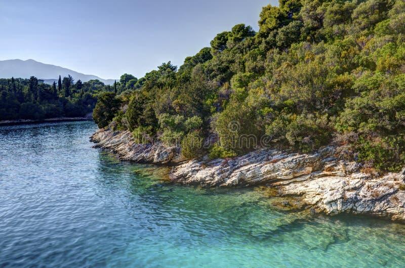 Côte d'île de Skorpios, Grèce photographie stock libre de droits