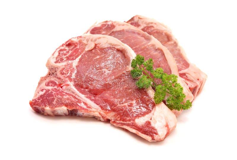 Côtelette crue d'échine de porc images libres de droits